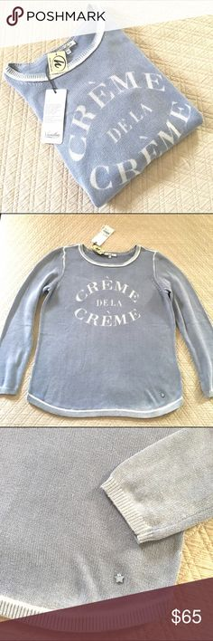 """Vanilia Crème de la Crème Knit Sweater Beautiful baby blue knit lightweight sweater by Vanilia. 'Crème de la Crème"""" statement on the chest. White detailing around hem lines, white fade out original to sweater as purchased. Size 40 European (generally size 10 or medium US) new with tags, never worn. 27.5in from top seam to bottom hem. Vanilia Sweaters Crew & Scoop Necks"""