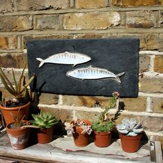 Garden Art Pisces Fish Mosaic, porcelain and up-cycled slate, eco art. £70.00, via Etsy.