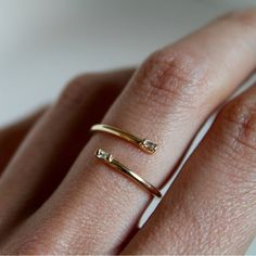 Visibly Interesting: Lumo minimalist 14K Yellow Gold double Diamond baguette cuff ring features two 2x1.5mm White Diamond baguettes accenting the ends of a coiled band