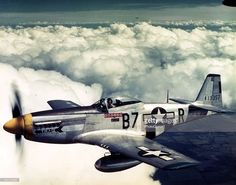 Aerial view of American pilot Lieutenant Vernon L. Richards as he flies a North American Aviation P-51D Mustang fighter plane, nicknamed 'Tika IV,' over England, 1945.