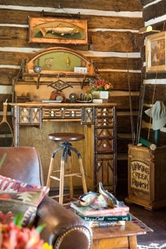 fishing theme in the great room of this campy and cute log home