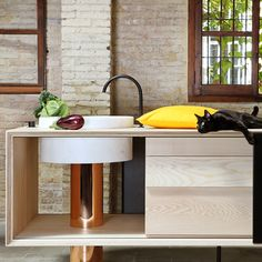 """MUT Design uses copper, marble and ash for """"seductive"""" freestanding kitchen"""
