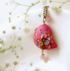 BIRDIE in fuschia colour. Beautiful handmade polymer clay bird pendant. Made to order. $53.00, via Etsy.