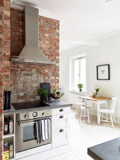 brick and white kitchen with stainless steel #gorgeous #simple