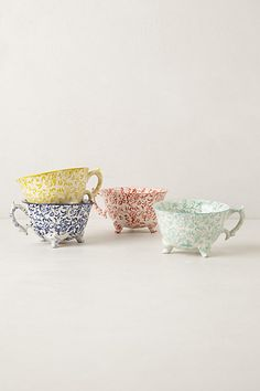 anthropologie...attingham teacups...their site only lists the dark blue and pale blue turquoise colors as options now...love the feet...
