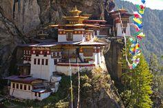 Hike to the famed Taktsang (Tiger's Nest) Monastery near Paro in Bhutan.
