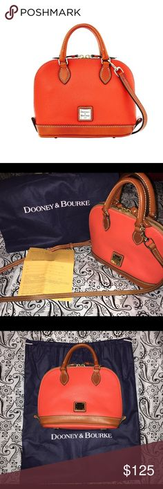 """🎉HP SALE🎉 FINAL! DOONEY  & BOURKE PEBBLE GRAIN BITSY BAG IN THE GORGEOUS COLOR PERSIMMON! AUTHENTIC!!! NO SCRATCHES NO SCUFFS ON LEATHER!!                        Measures approximately 9-1/4""""W x 7""""H x 3-1/2""""D with a 25"""" to 27"""" strap drop and 3"""" handles; weighs approximately 1 lb, 3 oz                                                            ✅Prices are negotiable: Please be considerate due to Poshmark fees. ✅No holds/No Trades ✅Please use offer button ✅No 🅿️🅿️ Dooney & Bourke Bags Mini…"""