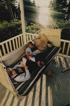 """From original source (""""National Geographic Scans Tumblr): """"Maine, June 1977.""""  In a later Tumblr post, gentle-insomnia had added further information: """"Adventuring in books on the swing of grandmother's porch, two vacationing children store up present knowledge and future memories on Squirrel Island."""" - National Geographic, 1977, photographed by David Hiser."""