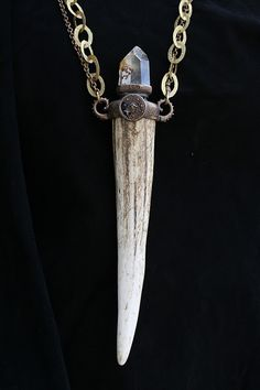 Antler tip with quartz crystal pendant.