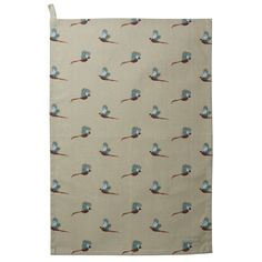 Sophie Allport Pheasant Tea Towel: This teatowel by Sophie Allport features the magnificent long tailed male Pheasant gamebird flying across a stone green background. Sophie has captured the distinctive rich chestnut, golden-brown and black markings on the body and tail, with a dark green head, red face wattling and white ring around the neck. There is a handy 'loop' on the top left corner of the tea towel so you can hang it up in your kitchen.