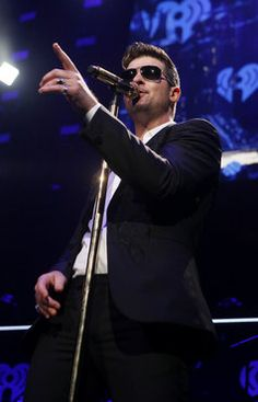 Robin Thicke performs at Q102's Jingle Ball 2013 at the Wells Fargo Center in Philadelphia on December 4.