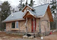 cord wood buildings | Michael Fuller designed & built this beautiful cordwood cottage near ...