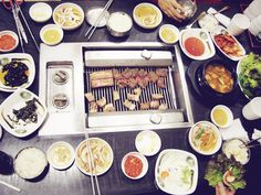 Korean barbeque & their million side dishes  .