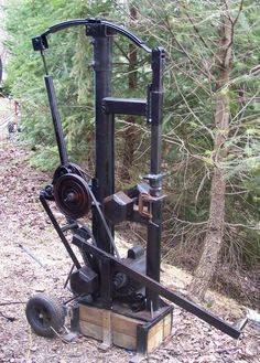 my 35 lb. appalachian style power hammer I built for 100 dollars and 50 hours labor
