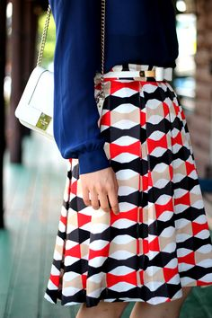 Kate Spade bow kkirt with royal blue top and white handbag for a classic look.