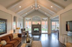 beautiful small living room vaulted ceiling / The Growth of the Small House Plan   images courtesy of Houseplans.co