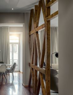 Beautiful #rustic #roomdivider.  Adds great texture and character to the space.  Cristina Jorge de Carvalho | Interior Design Lisbon Apartment