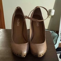 Also tan wedge Hill absolutely gorgeous Also tan wedge Hill absolutely gorgeous worn once great shape golden bronze buttons strap can go on or off around the ankle ALDO Shoes Wedges