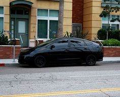 Something different, a murdered out, all black toyota prius