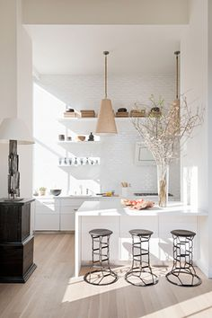 All white kitchen // breakfast bar // pretty  details  - Would i be able to have this in my room?