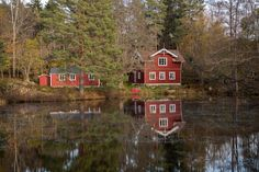 Red house by the lake by Ole Morten Eyra