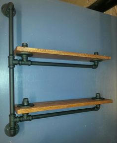 Pipe shelves can be one way to accomplish desired looks. Many people decide to build their own industrial pipe shelves that incorporate these aesthetic features for a variety of reasons. Diy Pipe Shelves, Industrial Pipe Shelves, Bar Shelves, Industrial Living, Industrial Interiors, Industrial Furniture, Industrial Style, Pipe Shelving, Industrial Cafe