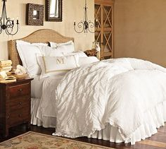 I love the textured white comforter and hanging lamps; country meets elegance