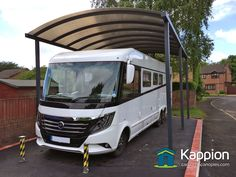 A very tall motorhome canopy installed in Manchester, protecting a motorhome from the elements. Custom designed, expertly manufactured and installed. Portable Carport, Diy Carport, Carport Canopy, Carport Kits, Rv Garage, Steel Garage, Garage Kits, Rv Carports, Metal Carports