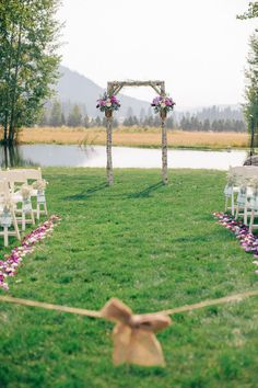 Rustic Washington Destination Wedding from Vienna Glenn Photography | Mountain Springs Lodge, Leavenorth, Washington | birch log altar + purple flowers   Read more - http://www.stylemepretty.com/destination-weddings/2013/06/13/rustic-washington-destination-wedding-from-vienna-glenn-photography/
