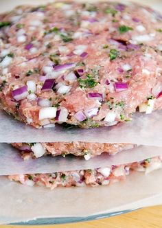 1 lb. ground turkey meat (prefer thigh meat) 1 medium red onion, finely chopped 1/2 cup fresh parsley, minced (or whatever fresh herbs you like) 1 tbsp garlic powder 1 tsp salt 1 tsp pepper cheese (optional)  Mix ingredients together and form 4-6 patties. Grill on medium heat for 7 minutes a side. 2 minutes before burgers are done, place a slice of cheese (optional) on each patty. Serve hot.