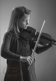 Playing the violin,Black and white, natural light photography, daylight studi, window
