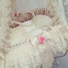 Moses basket covered with embroidered linen.