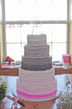 ombre wedding cake Like the concept, but would want the transition into the colors to look better!!