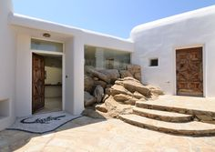 I love how they managed to blend the rocks into the architecture in this hotel in Mykonos, Greece.
