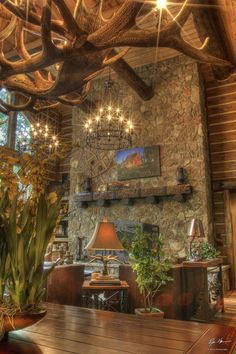 Mmm mm mmm mm mmmm Love the antler chandeliers, the hearth and stone and glow!
