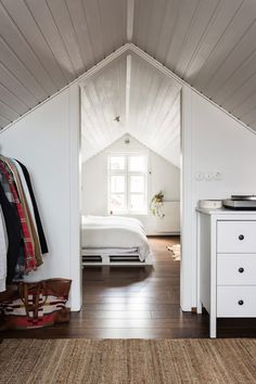 The bedroom has a bed that Anthony built of old pallets. The house's attic has…