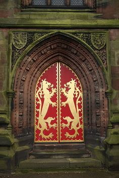 Giles Church - Cheadle in Staffordshire, England. The splendid west doors of St Gile's church in Cheadle has two gilded rampant lions, a device from the arms of John Talbot, Earl of Shrewsbury who financed this glorious church in