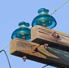 The glass pin type insulators and wooden crossarm.
