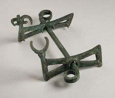 circa 1000-650 B.C., Iran, Luristan, Luristan bronzes, Tools and Equipment; horse trappings Bronze, cast Cheekpieces: Height: 3 1/4 in. (8.5 cm); Length: 5 in. (12.5 cm); Mouthpiece: Length: 7 1/2 in. (19 cm) The Nasli M. Heeramaneck Collection of Ancient Near Eastern and Central Asian Art, gift of The Ahmanson Foundation (M.76.97.115)