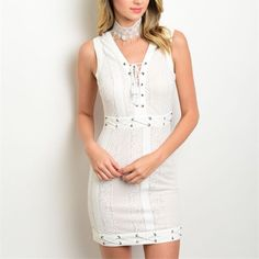 "HOST PICK White Lace Up Dress White and cream dress - beige with white overlay. Lace up detailing at waist, hem, and cheat. Zip up back with hook and eye closure. 90% nylon, 10% spandex. Small fits a 26"" waist and is 32"" long from high point of shoulder to hem. Dresses"