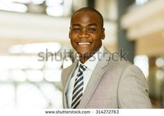 close up portrait of male african american corporate worker - stock photo