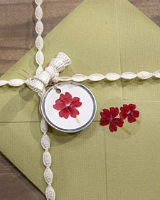Use pressed flowers to make fun gift tags or stationery for gardeners. Learn how from Martha Stewart.