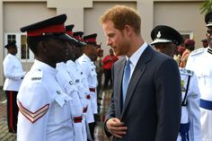 Prince Harry Photos Photos - Prince Harry inspects a guard of honour as he arrives into St Georges on the ninth day of an official visit to the Caribbean on November 28, 2016 in St Geoorges, Grenada. Prince Harry's visit to The Caribbean marks the 35th Anniversary of Independence in Antigua and Barbuda and the 50th Anniversary of Independence in Barbados and Guyana. - Prince Harry Visits The Caribbean - Day 9