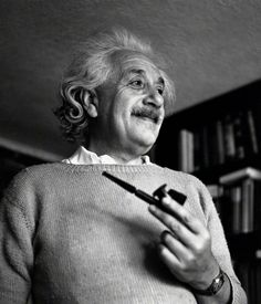 Princeton, New Jersey, USA --- A smiling Albert Einstein at home in his Princeton study, with a favorite pipe and tobacco tamper in one hand. Marie Curie, Philosophy Of Science, People Smoking, Theory Of Relativity, E Mc2, Pipes And Cigars, Up In Smoke, Physicist, Cigars