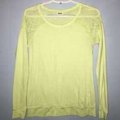 Victoria's Secret PINK Raglan Tee This Victoria's Secret PINK Long Sleeved Top with Lace Shoulders  it is a size X-Small and A light lime green color. PINK Victoria's Secret Tops Tees - Long Sleeve
