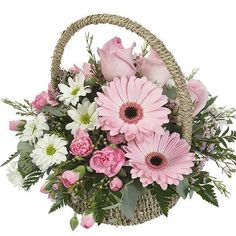 The Flowers are arranged in a cute round basket and the lovely color combination is quite pleasing to the eye. Send flowers online to your loved ones through Our Our Small and Cute Flower Basket makes a perfect gift for all occasions. Send Flowers Online, Online Flower Shop, Online Flower Delivery, Basket Flower Arrangements, Floral Arrangements, Exotic Flowers, Small Flowers, Pretty Flowers, Flower Shop Dubai