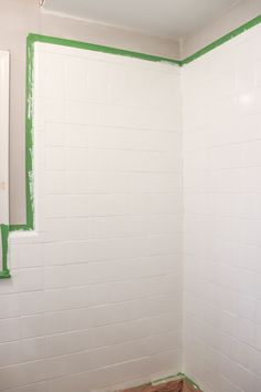 Before you rip out your ugly bathroom tile, you should read this! We changed our bathroom tile for $150 bucks and it looks amazing! Painting Bathroom Walls, White Bathroom Tiles, Tub Tile, Bath Tiles, Bathroom Floor Tiles, Bathroom Renos, Small Bathroom, Tile Painting, Floor Grout