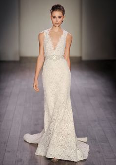 Ivory venise lace trumpet bridal gown over cashmere chiffon, V neckline with high back, natural white stone belt at waist sold separately, chapel train. Style 3611 by Lazaro