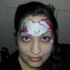 Christmas Hello Kitty face painting paint painter. By Glitter Goose! (design found on pinterest)
