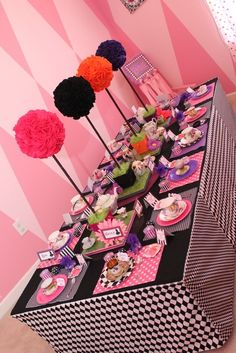 Mad Hatter tea party table: black and white checks with red pops of color